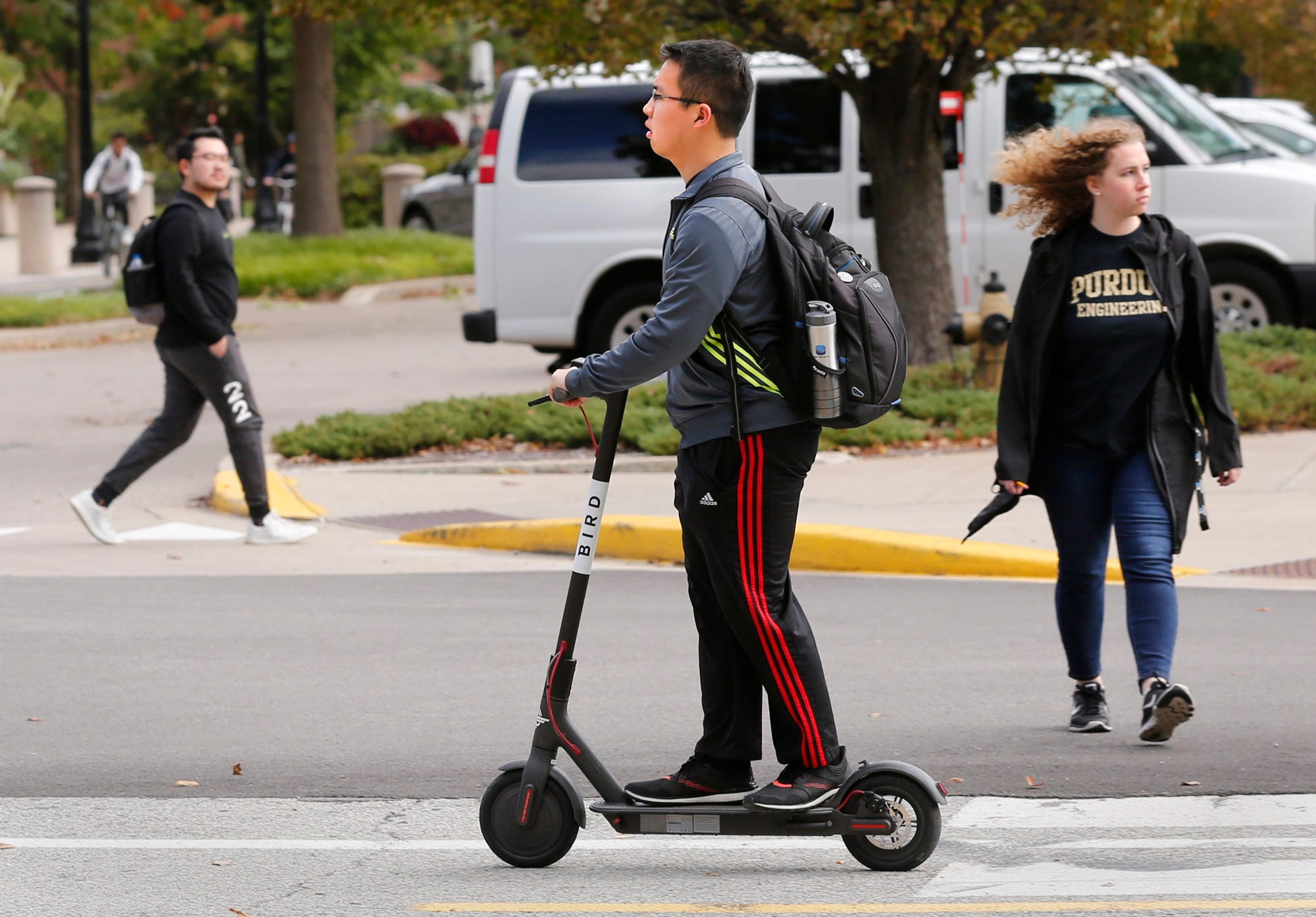 A student rides a BIRD electric scooter Thursday, October 11, 2018, on the campus of Purdue University in West Lafayette.