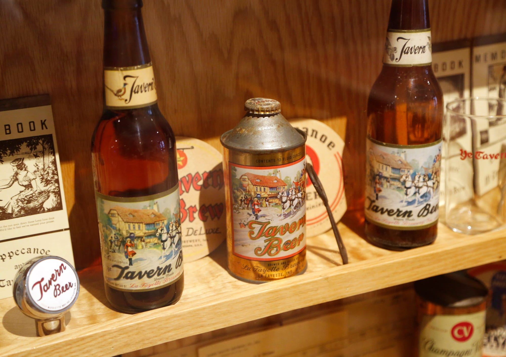 Beer memorabilia, including a wide variety from the original Thieme & Wagner Brewing Company, grace the walls of Thieme & Wagner Brewery Wednesday, October 10, 2018, at 652 Main Street in Lafayette.