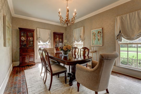 The formal dining room is large enough for any family gathering.