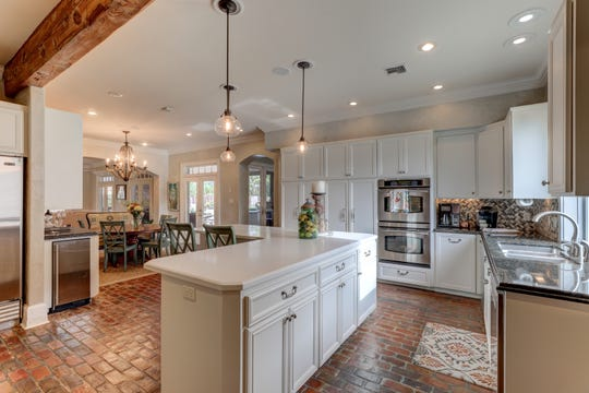 The kitchen features top of the line appliances.
