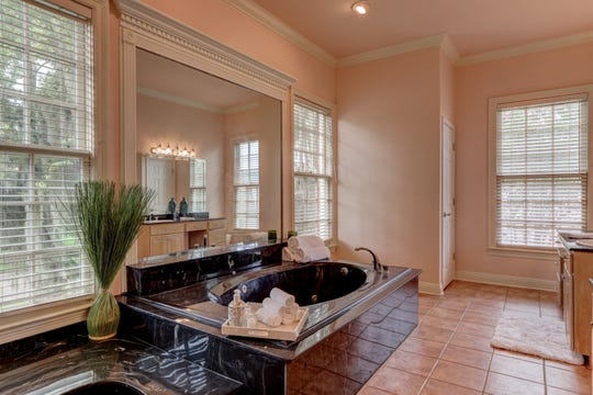 The master suite is fit for a king or queen.