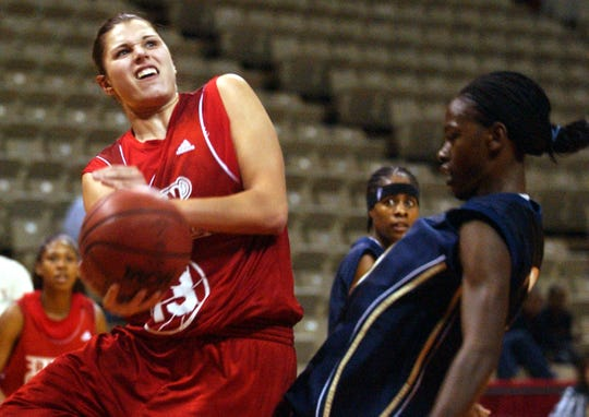 UL's Anna Petrakova is fouled while shooting a layup during a 2004 exhibition game at the Cajundome in Lafayette. Petrakova will be inducted to the Louisiana Athletic Hall of Fame on Friday as part of Homecoming festivities.