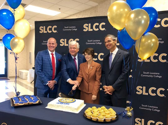 Acadian Companies and South Louisiana Community College celebrate a 15-year partnership Thursday at their National EMS Academy. From left are NEMSA Chief Medical Officer Dr. Charles Burnell, Acadian Companies Chairman and CEO Richard Zuschlag, SLCC Chancellor Natalie Harder and state Sen. Fred Mills.