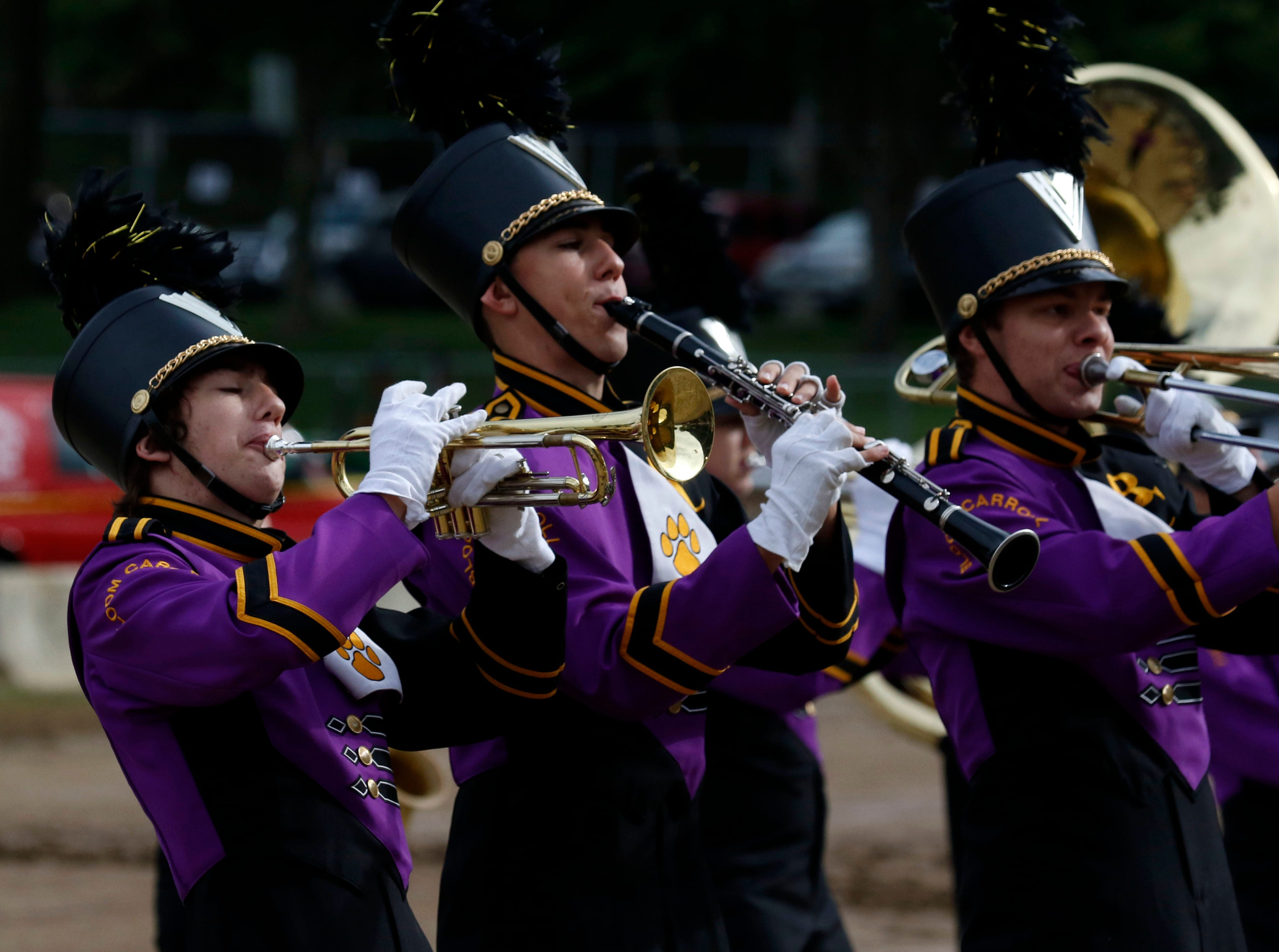 Nick LaSalle, left, Sam Graham and Vincent Brausch perform with the Bloom-Carroll High School Marching Bulldogs Thursday morning, Oct. 11, 2018, during the Parade of Bands at the Fairfield County Fair in Lancaster. Bands from eight high schools in the county performed to a crowded grandstand of spectators.