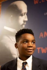 DuBois student Ja'Kim Jordon, 11, stands in front of a photo at school of civil rights leader W.E.B. DuBois.