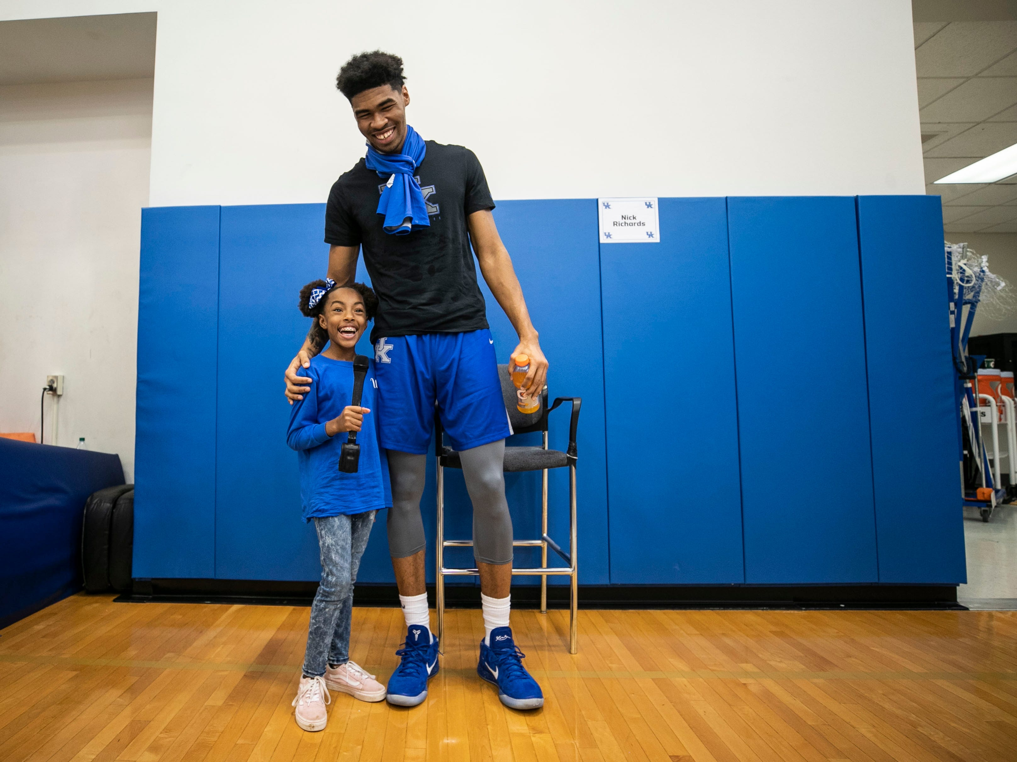 Fifth-grade student Elijah Mayborn, 10, of Lexington smiles with the tallest UK player, Nick Richards, during media day Thursday afternoon