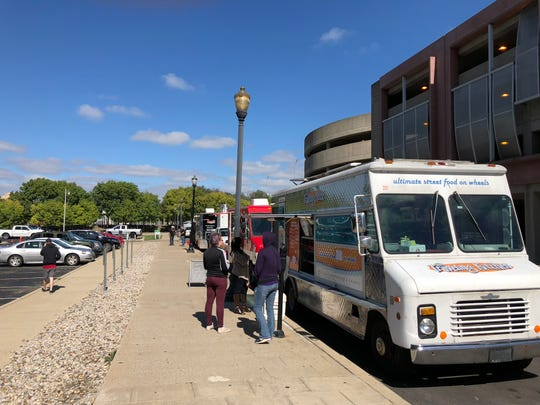 Food trucks set up on Brook Street near Witherspoon Street in Louisville on Oct. 11, 2018.