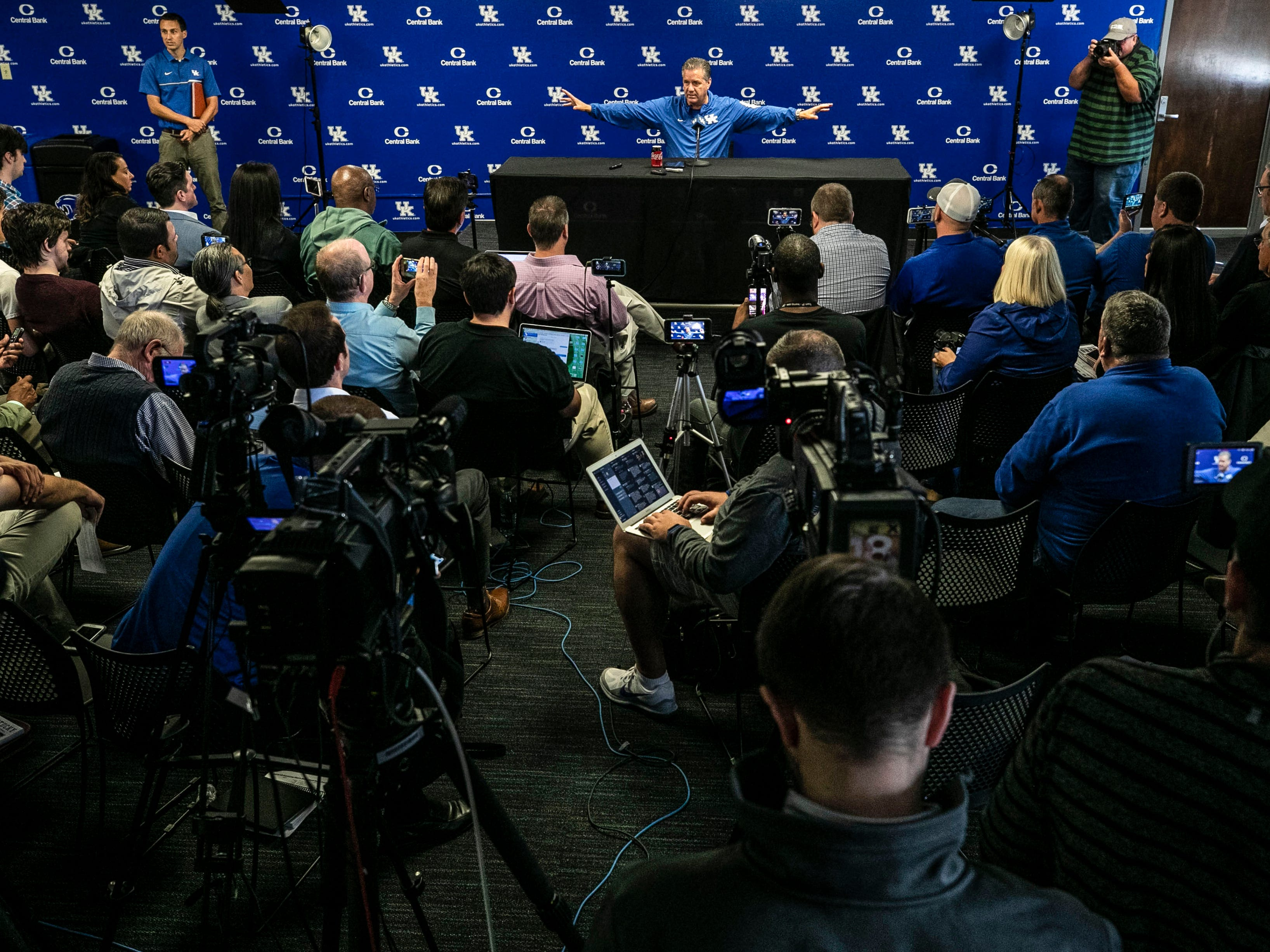 As around 100 reporters, bloggers and camera people crowded into the media room at the Joe Kraft Center, Kentucky basketball coach John Calipari talked about the UK football team's success as well as gave a several minutes-long answer about players and the NBA during a 45 minute press conference about the 2018-19 team Thursday afternoon in Lexington.
