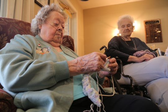 Wanda Flor, left, and Shirley McLaughlin work on their knitting projects during a session of the Busy Bees group at the Primrose Retirement Community of Mansfield.
