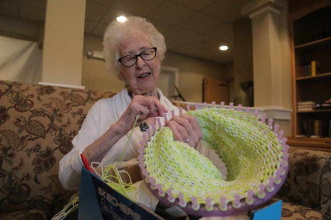 Sophia Bailey knits a hat as part of the Busy Bees group at the Primrose Retirement Community of Mansfield.