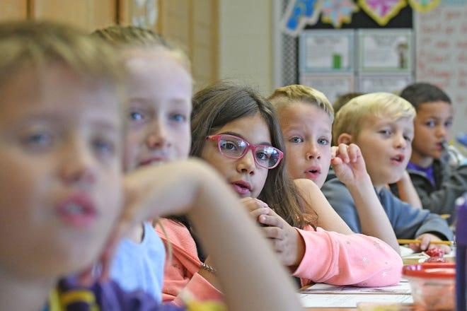 Third-grade students listen during a math lesson in  teacher Megan McCammon's class Thursday morning at Central Elementary in Lexington.