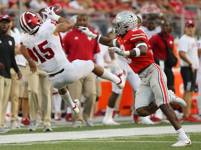 Ohio State cornerback Kendall Sheffield can't stop Indiana's Nick Westbrook from catching a pass as he falls to the turf in the Buckeyes' 49-26 victory.