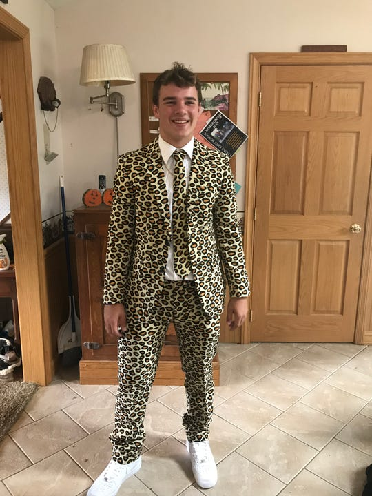 Lucas' Jeb Grover poses in his leopard-print suit before homecoming the day after he broke the school's career-rushing record.