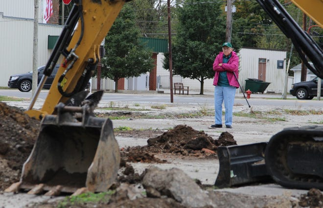 La Rue Mayor Paul Milton Lightfoot looks on as excavation begins Thursday at a vacant lot at 36 N. High St. in La Rue. At one time, there was a gas station and car repair shop on the lot, but now it sits empty, with redevelopment efforts stymied by the possible liabilities that come with the site's status as a former gas station. The Village of La Rue was awarded a $150,000 grant from the state to remove any underground fuel tanks and clean up the surrounding soil, which was found to be contaminated.