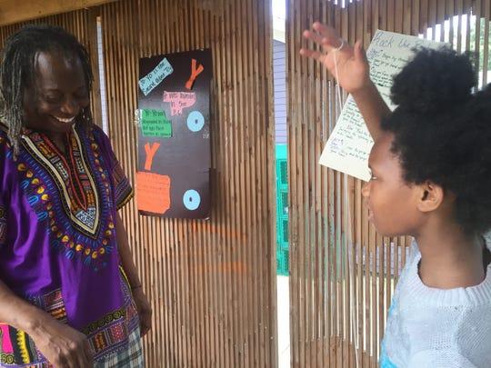 Henry Nelson and student Chinita Muhammad on Yo Yo Day at the Carpenter Art Garden.