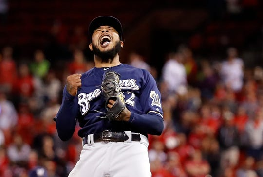 Milwaukee Brewers relief pitcher Jeremy Jeffress celebrates after striking out St. Louis Cardinals' Tyler O'Neill for the final out of a baseball game Wednesday, Sept. 26, 2018, in St. Louis. The Brewers won 2-1 to clinch a postseason spot.