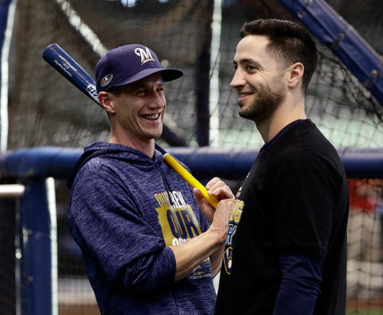 Brewers manager Craig Counsell and Ryan Braun watch batting practice Wednesday in preparation for Game 1 of the National League Championship Series.