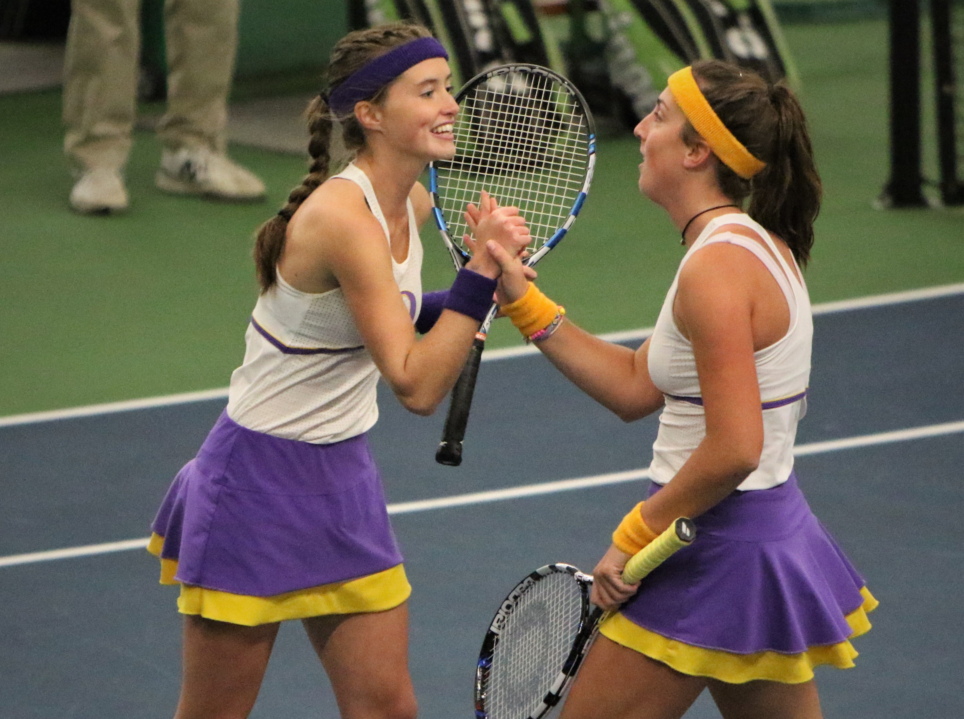 Oconomowoc's doubles team of Tori Krcmarik and Carolyn Tuff celebrates a point during a match at the WIAA state individual tennis tournament on Oct. 11.