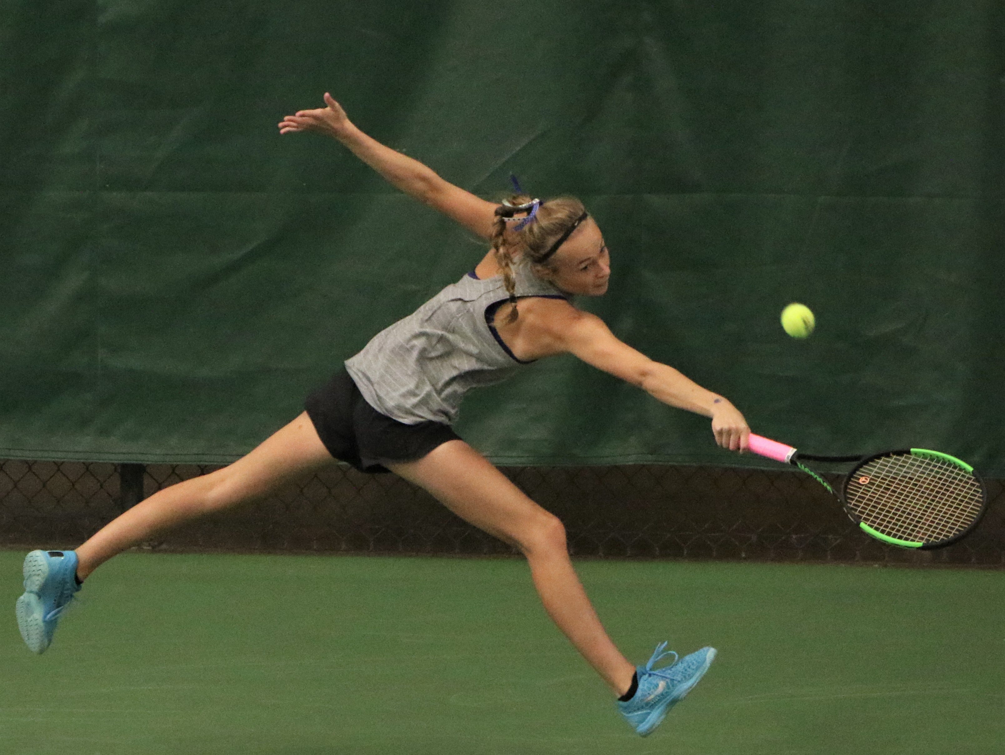 Waukesha West's Molly Asfeld reaches for a backhand shot during a match at the WIAA state individual tennis tournament on October 11.