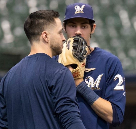 Outfielder Ryan Braun Christian Yelich stand by each other during practice on Thursday at Miller Park as the Brewers prepared to play in the NLCS.