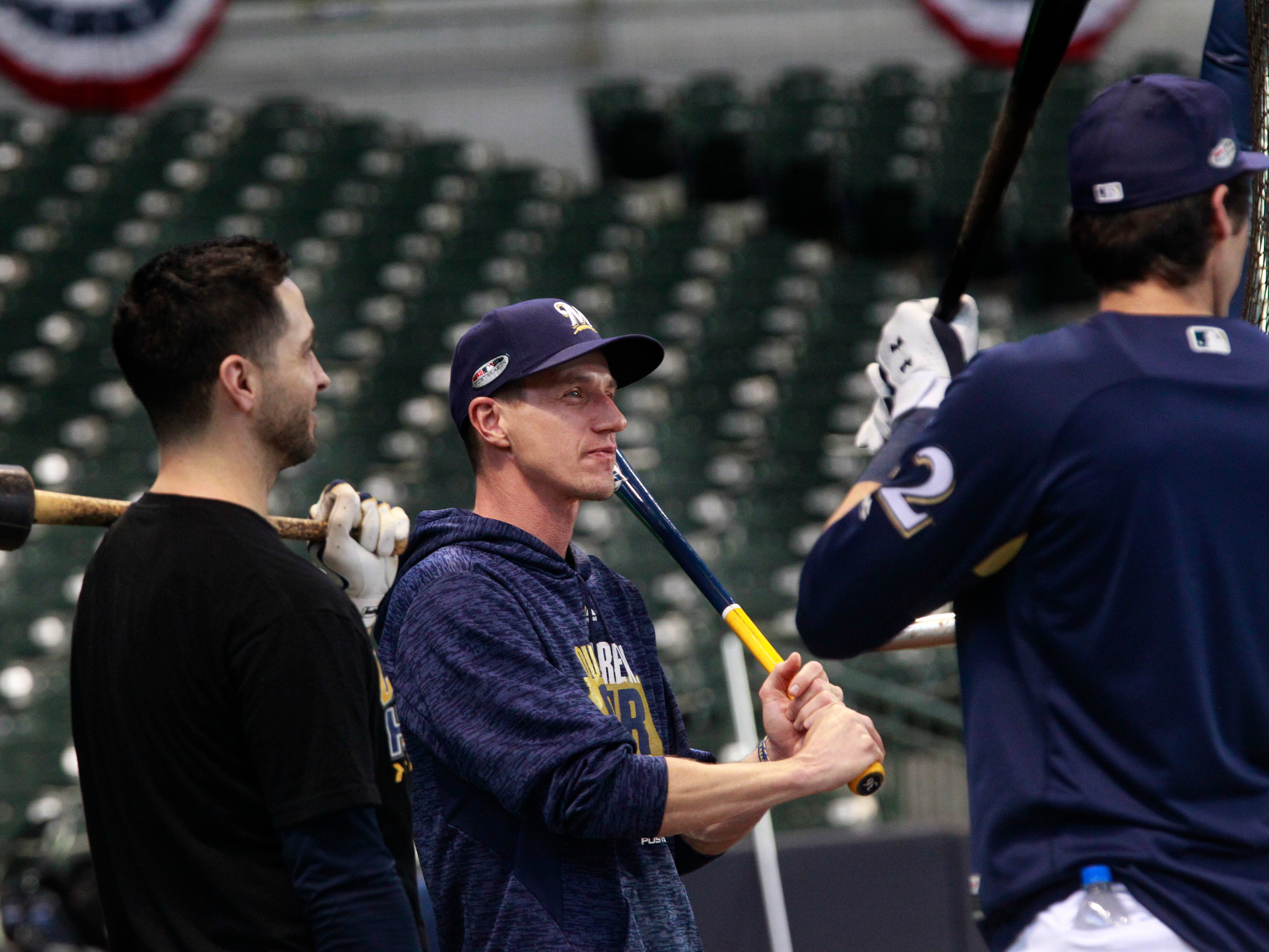 Ryan Braun talks with manager Craig Counsell during batting practice on Wednesday at Miller Park.