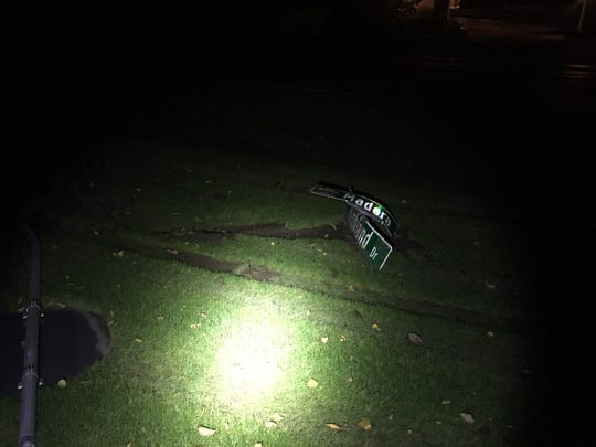 Debris left over after a 48-year-old Elm Grove woman struck a sign had run over a lawn at the intersection of Madera Cir. and Highland Dr. The woman was cited.