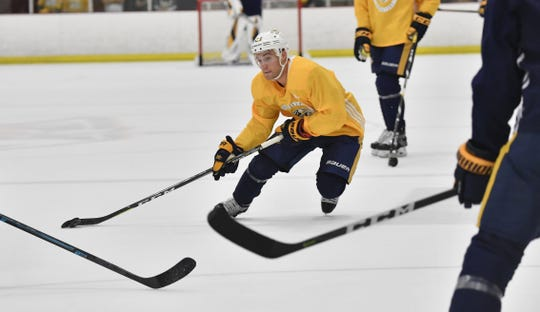 Rocco Grimaldi skates through the defense during Predators training camp. He was the last player cut by Nashville.
