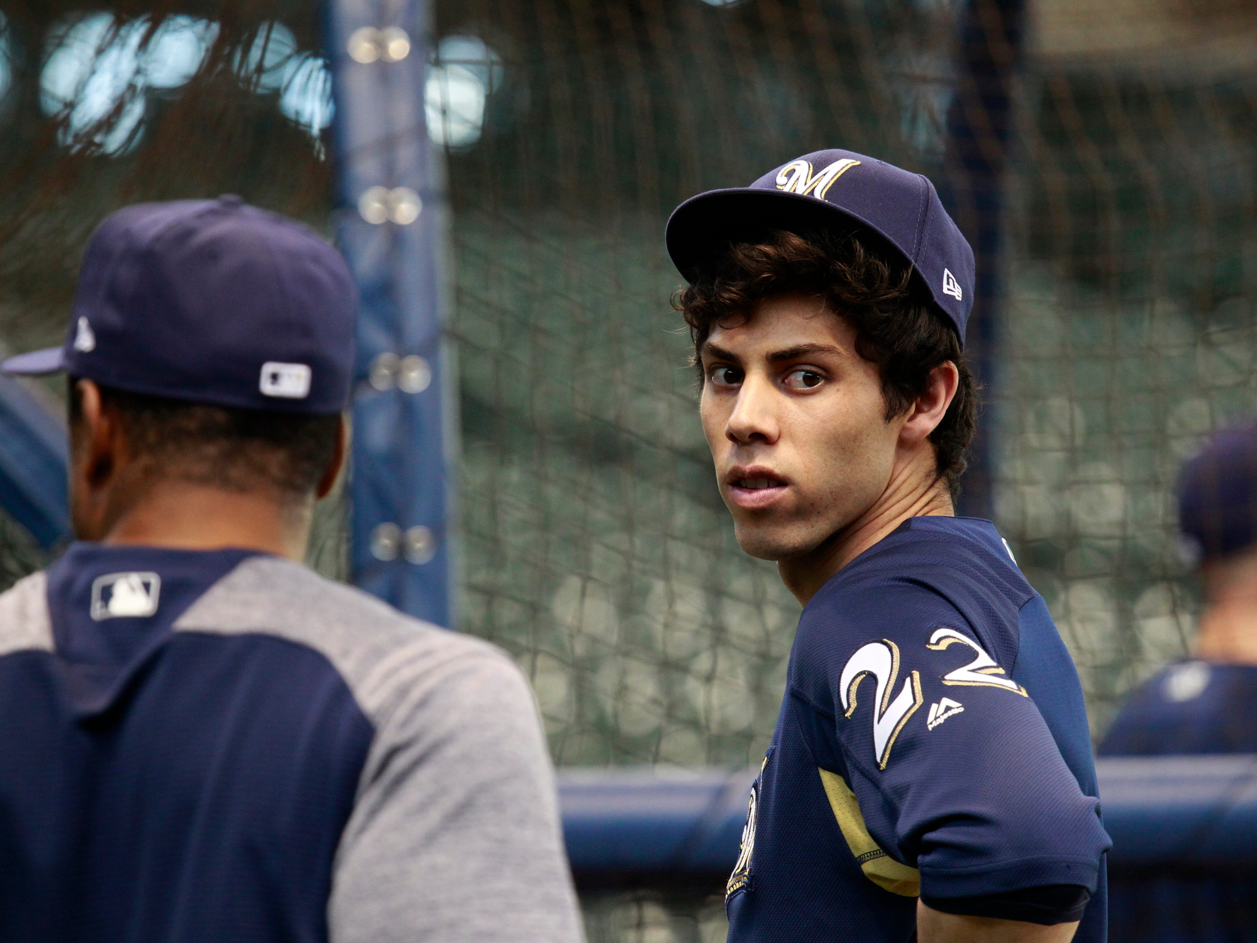 Brewers  outfielder Christian Yelich waits his turn to hit the batting cage during practice Wednesday at Miller Park.
