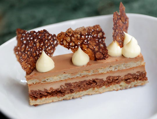 Fauntleroy's interpretation of Opera Torte includes dollops of lemon cream and espresso tuile over coffee mousse and hazelnut dacquoise layers.