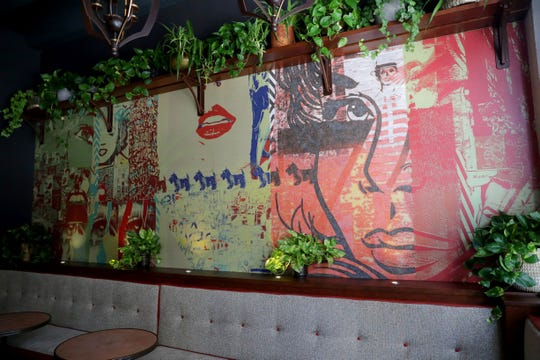 The murals in a lounge area at Fauntleroy and throughout the restaurant are by Scott Starr's Rev Pop design and advertising firm in Bay View.