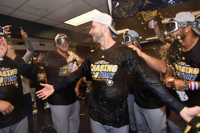 Leftfielder Ryan Braun celebrates with teammates after the Brewers advanced to the National League Championship Series for the first time since 2011. Braun is the only Brewers player remaining from that team.