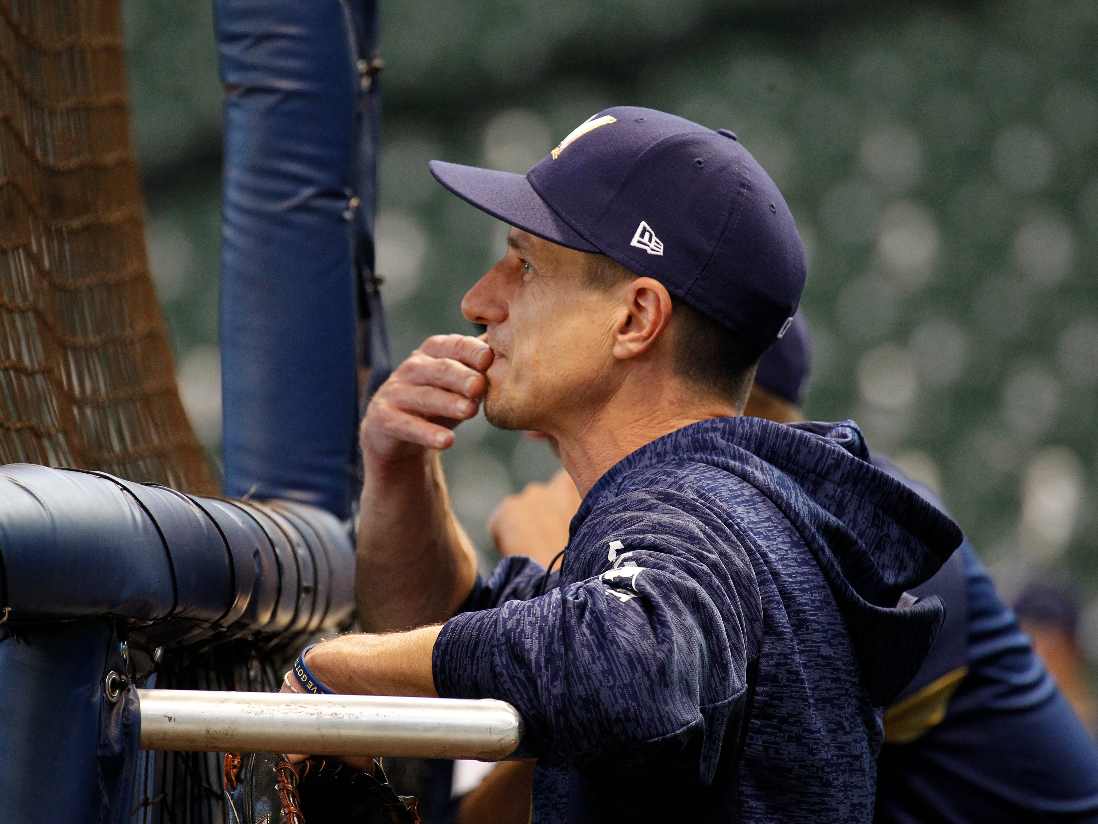 Brewers manager Craig Counsell watches practice from behind the batter's cage on Wednesday at Miller Park.