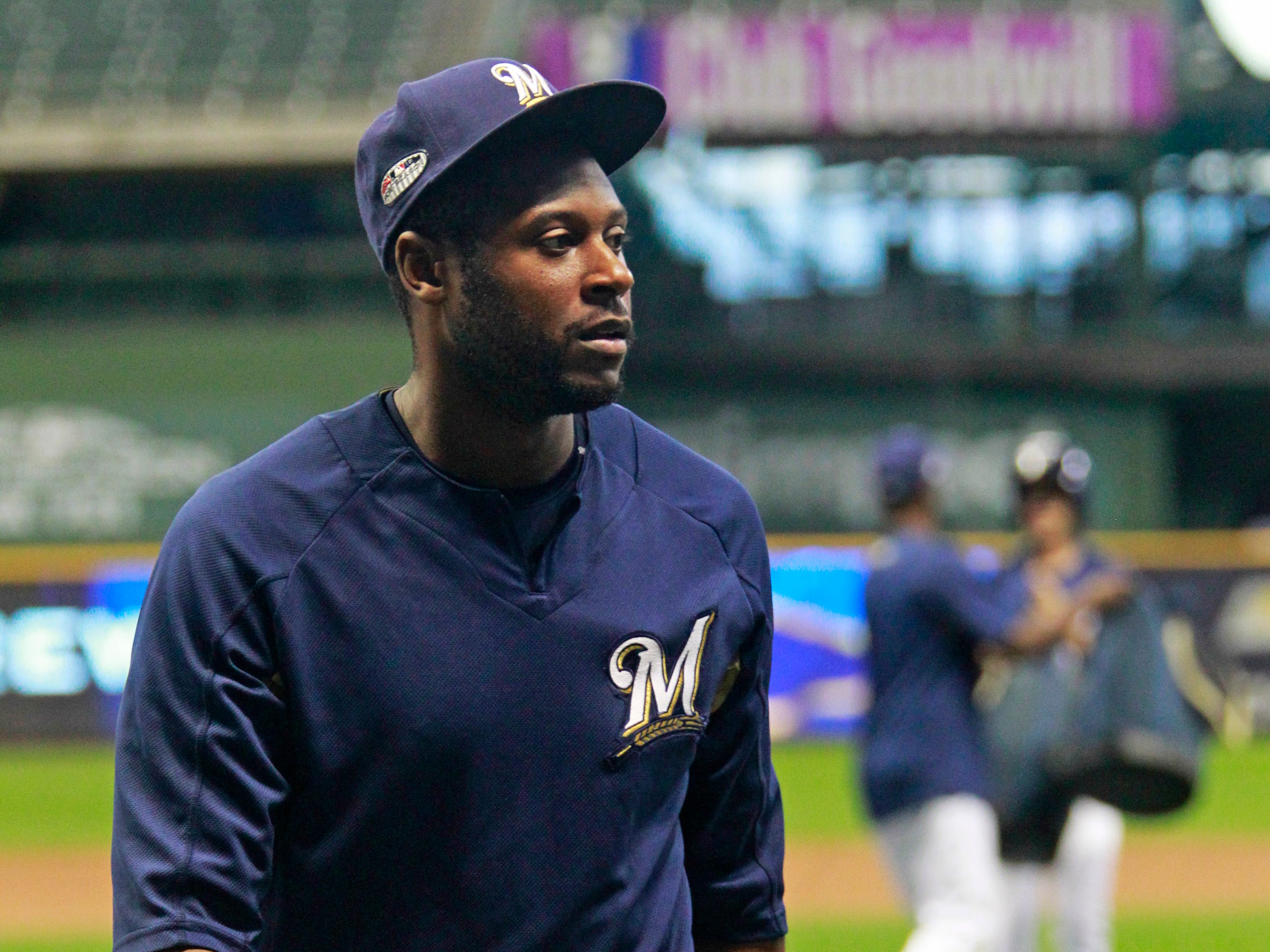 Brewers centerfielder Lorenzo Cain walks off field after practice on Wednesday at Miller Park.