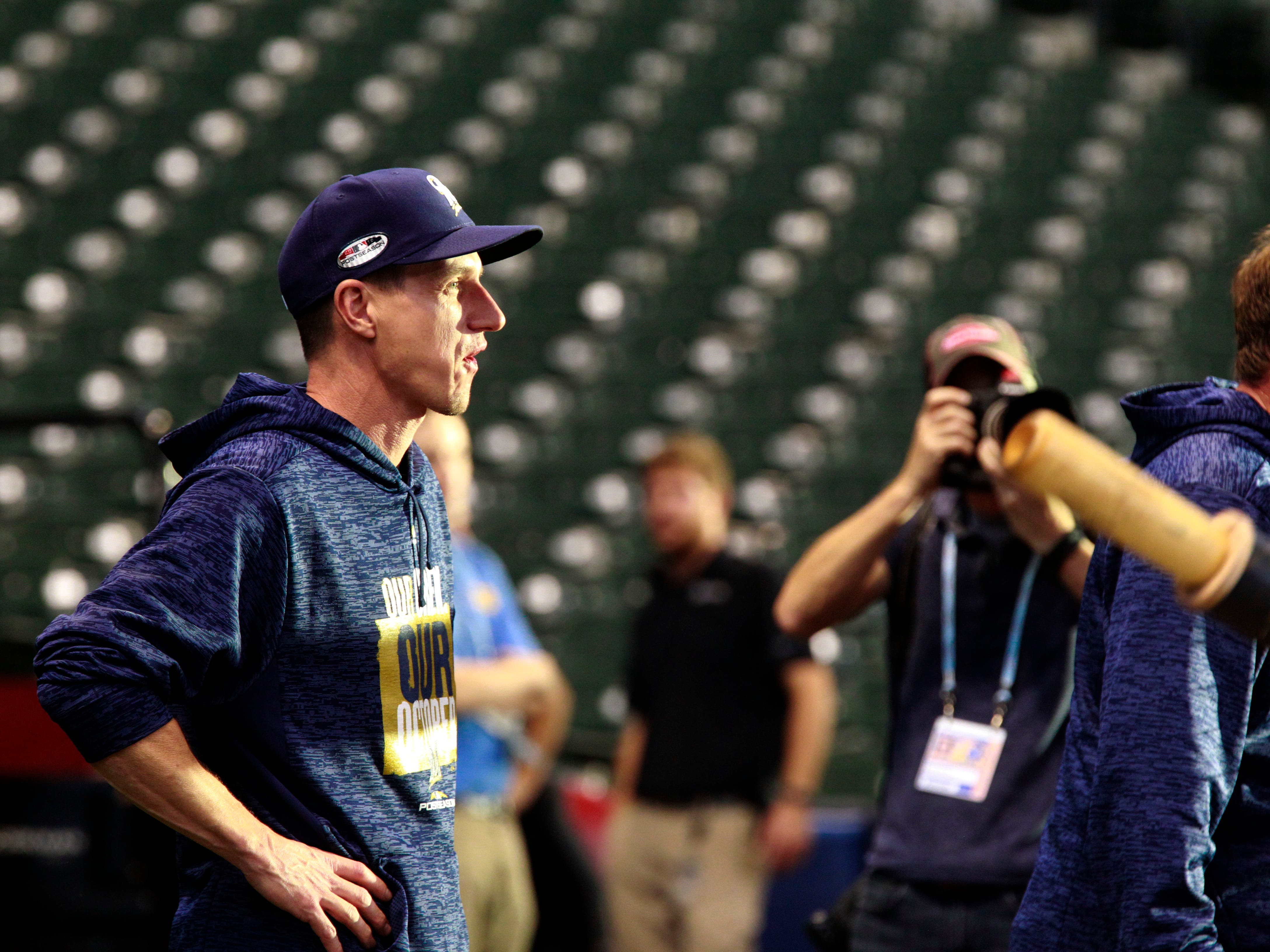 Brewers skipper Craig Counsell watches his team during batting practice on Wednesday at Miller Park.
