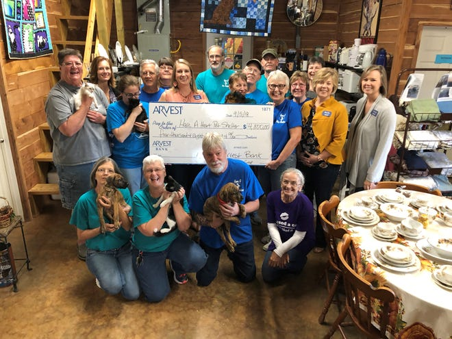 Arvest Bank recently presented Have a Heart Pet Shelter in Yellville with a check for $4,800. Pictured are: (first row, from left) Linda Mumau, Linda Moseley, David Marsalis, Katherine Miller; (second row) Shannon Moore, Dawn Cotter, Glori Cargel, Mike Manzer, Kathy Manzer, Lynn Wallace, Robert Bolton, Norma Mattingly, Denis Mattingly, Mark Dombkowski, Linda Vincent, Donna Zaerr, Linda Orr, Shelly Hill and Emily Smith.