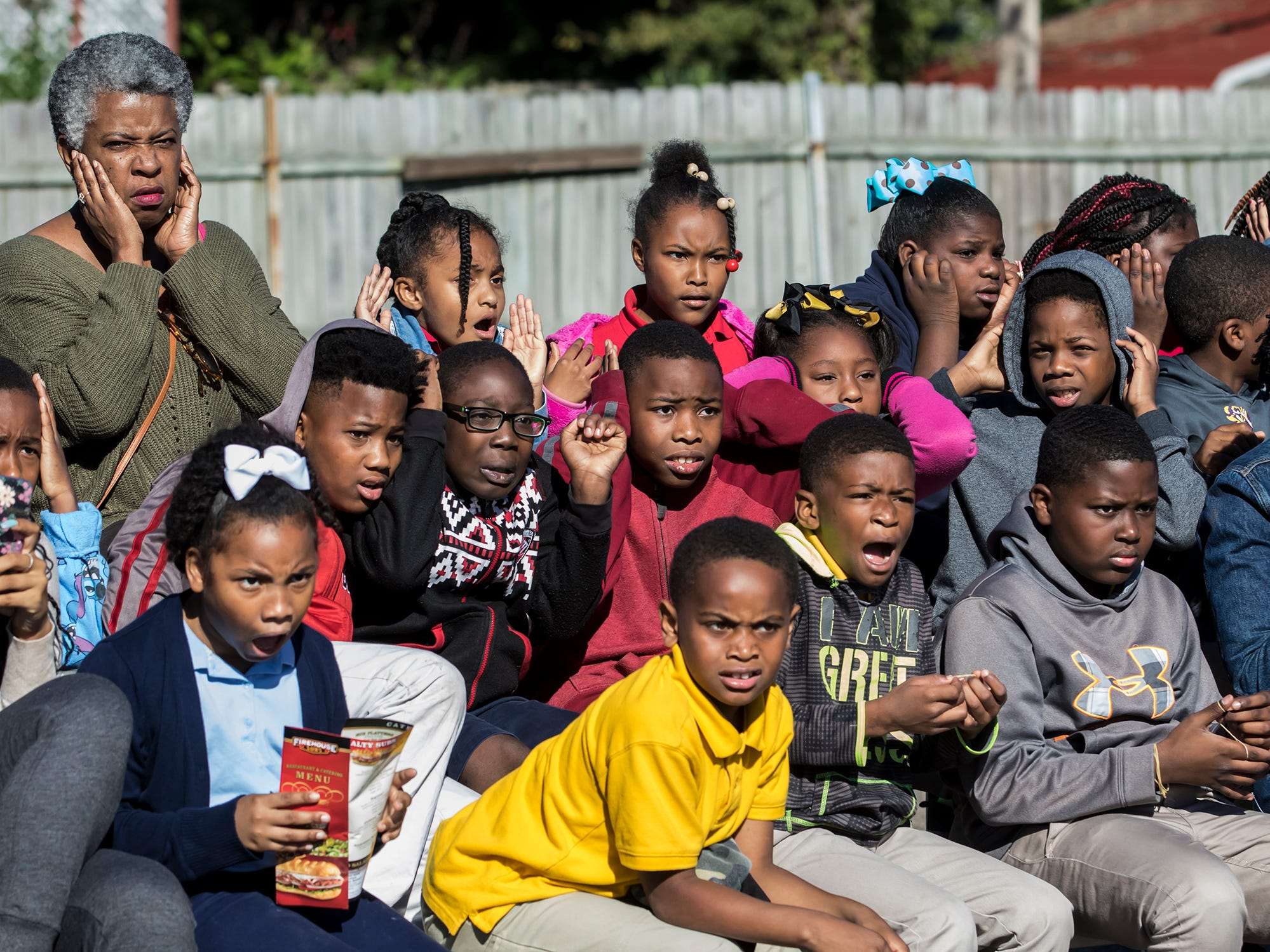 Children react to a car exploding during a fire prevention week demonstration held in Monroe, La. on Oct. 11.