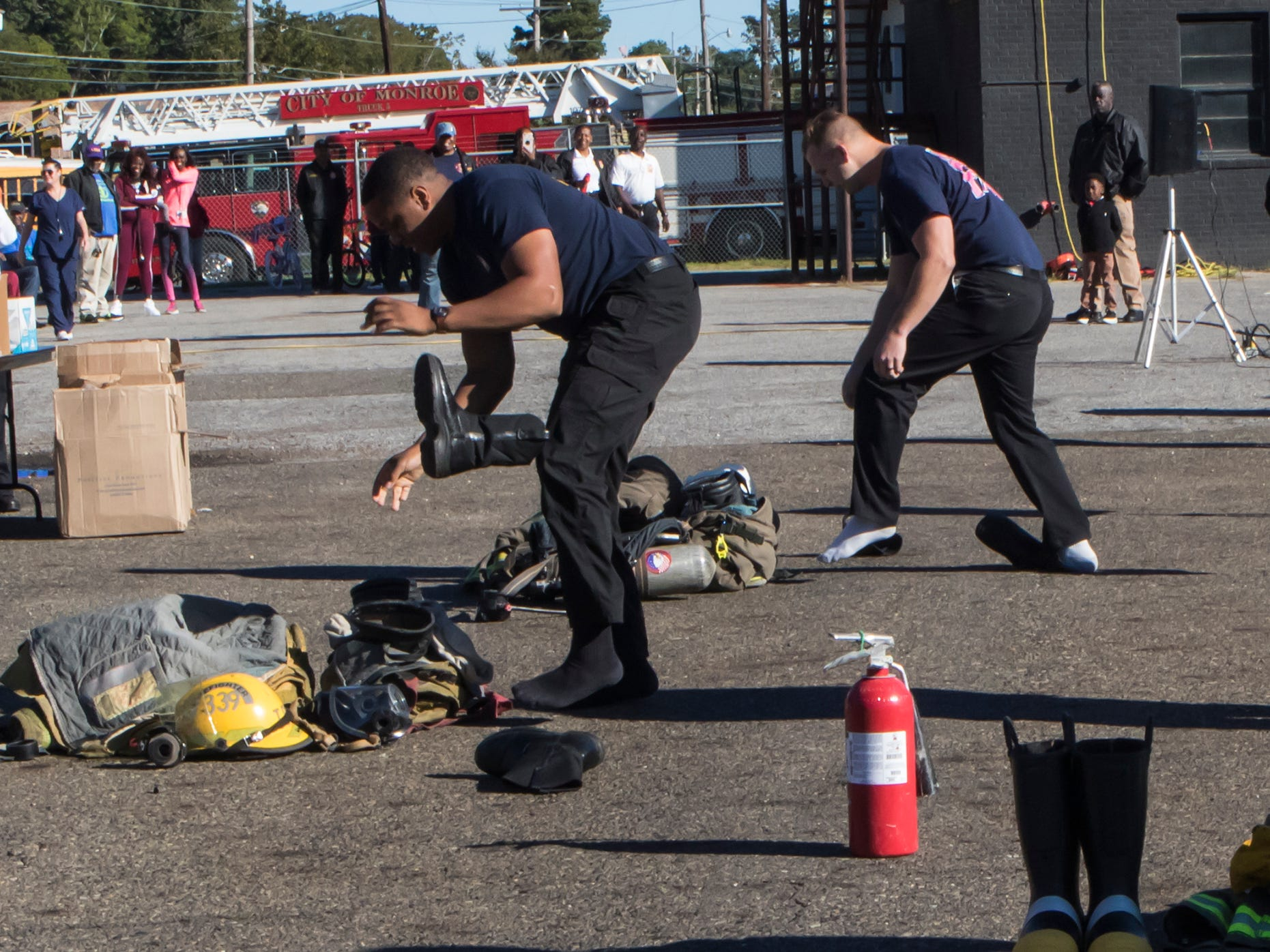 Monroe firefighters raced to get their protective gear on the fastest in front of a group of area grade school children during a fire prevention week demonstration held in Monroe, La. on Oct. 11.