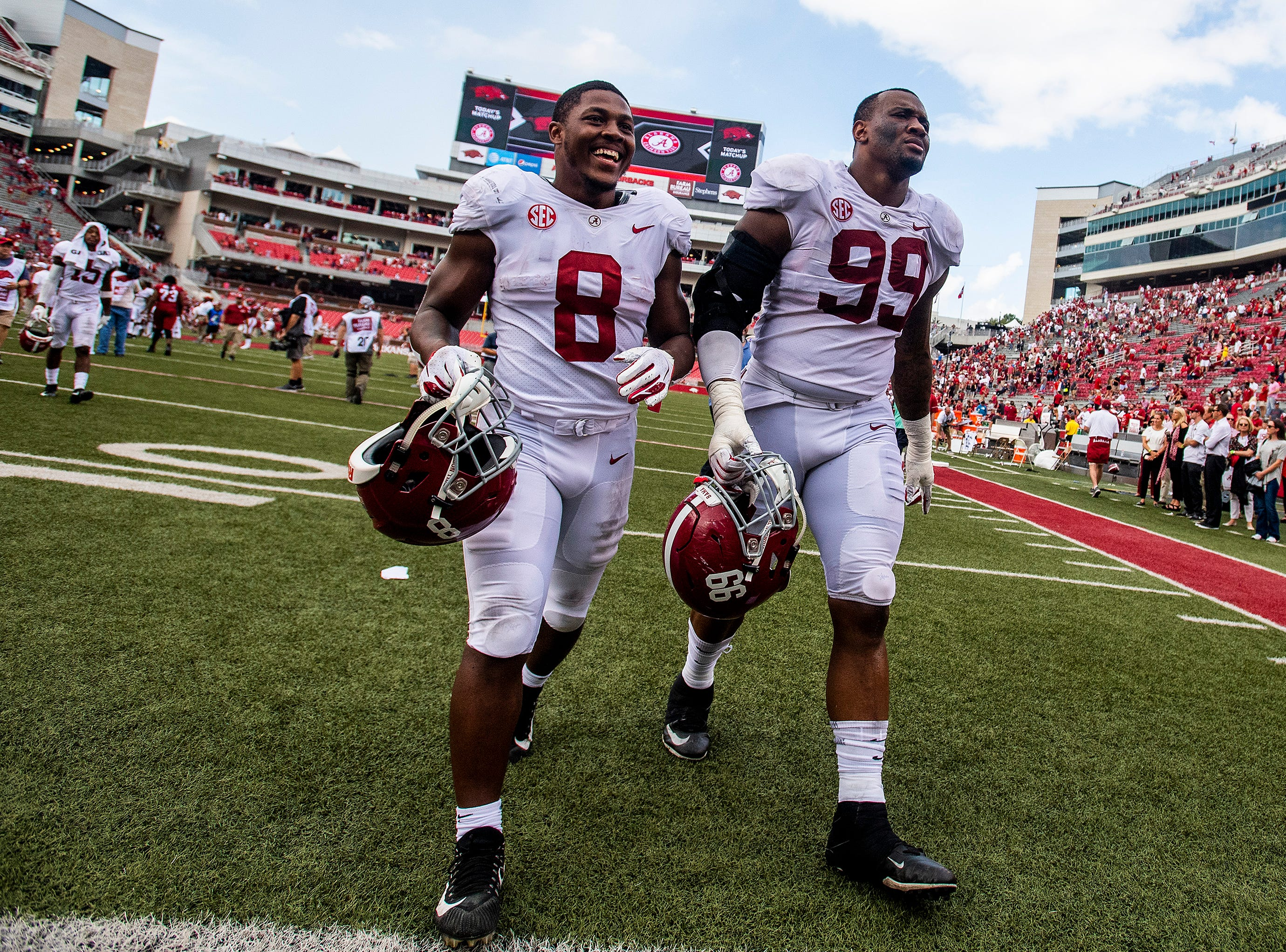 Alabama running back Josh Jacobs (8) and defensive lineman Raekwon Davis (99) walk off the field after defeating Arkansas during second half action in Fayetteville, Ark., on Saturday October 6, 2018.