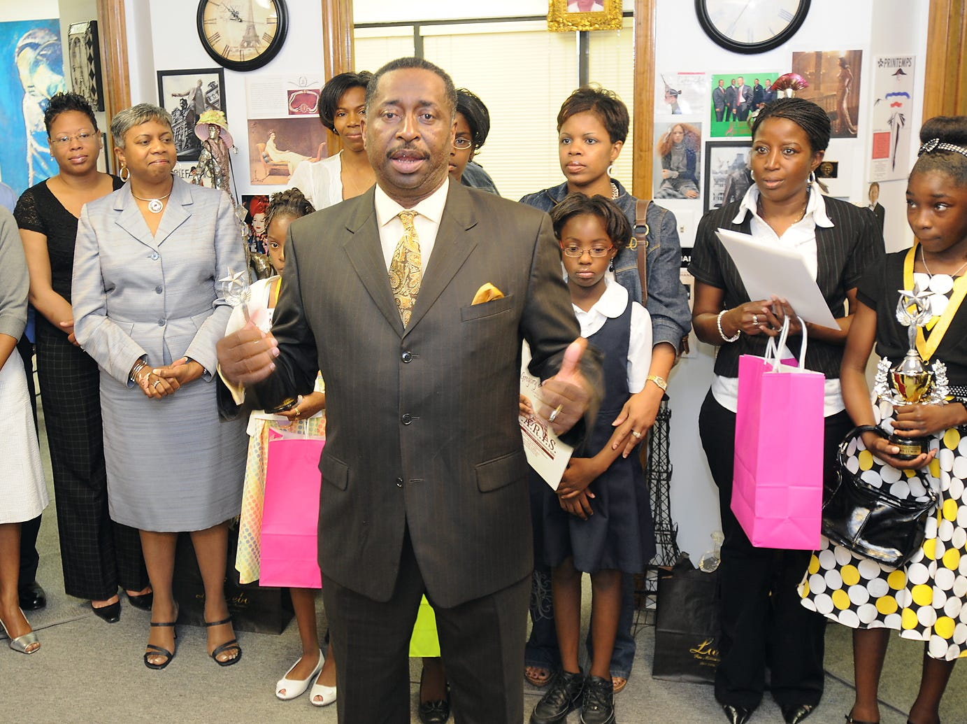 Greg Calhoun talks with students and their parents about the importance of family involvement in education  at Calhoun Enterprises, in Montgomery on Monday, April 28, 2008, at the grand opening of The Calhoun Paris Education Museum. Calhoun Enterprises joined forces with The Pilgrim Rest Missionary Baptist Church to honor and award students who were high scholastic academic achievers. In addition to receiving awards, the students were treated to a tour of The Calhoun Museum, which features replicas the Calhoun family's favorite paintings from The Louvre Museum in Paris. (Montgomery Advertiser, Jamie Martin)