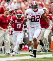 Alabama tight end Irv Smith Jr. (82) scores on the first play from scrimmage against Arkansas in Fayetteville, Ark., on Saturday October 6, 2018.