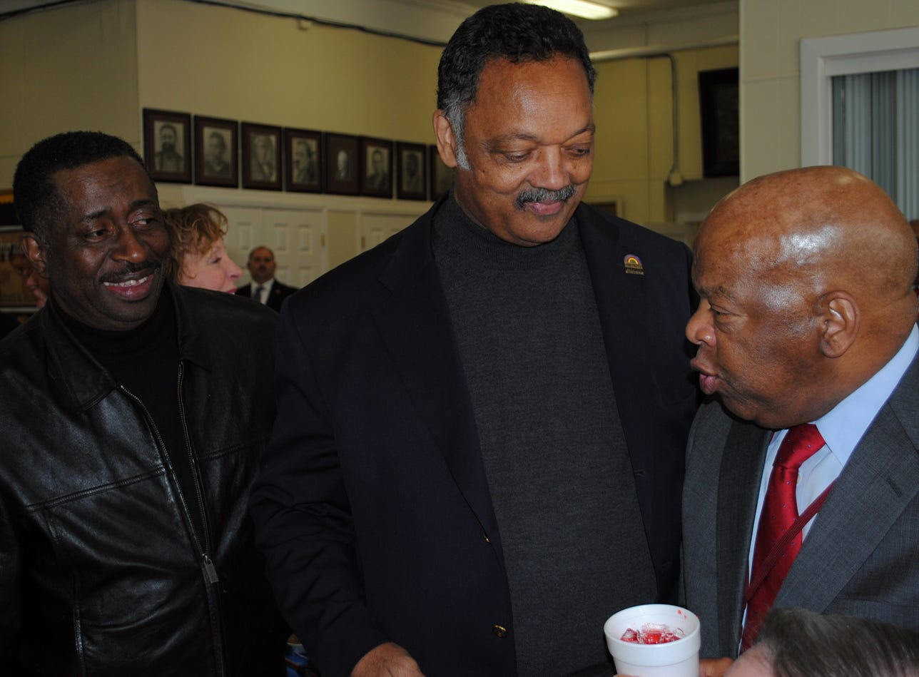 Greg Calhoun of Montgomery, left, chatted with the Rev. Jesse Jackson, center, and U.S. Rep. John Lewis during lunch at the First Baptist Church. Alvin Benn/Special to the Advertiser. 3-6-10