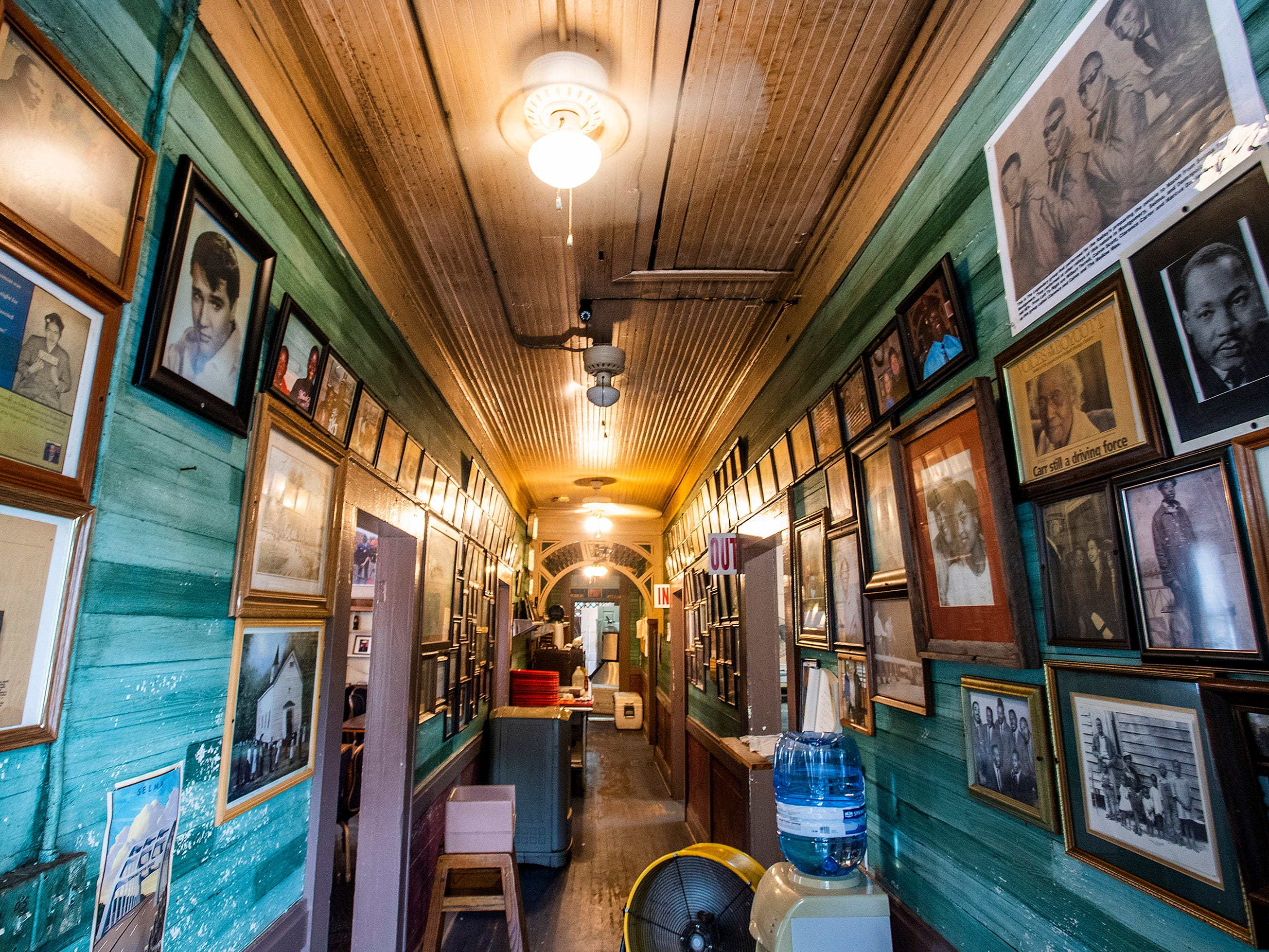Photos hang on the walls at Mrs. B's Home Cooking in Montgomery, Ala., on Wednesday October 10, 2018.
