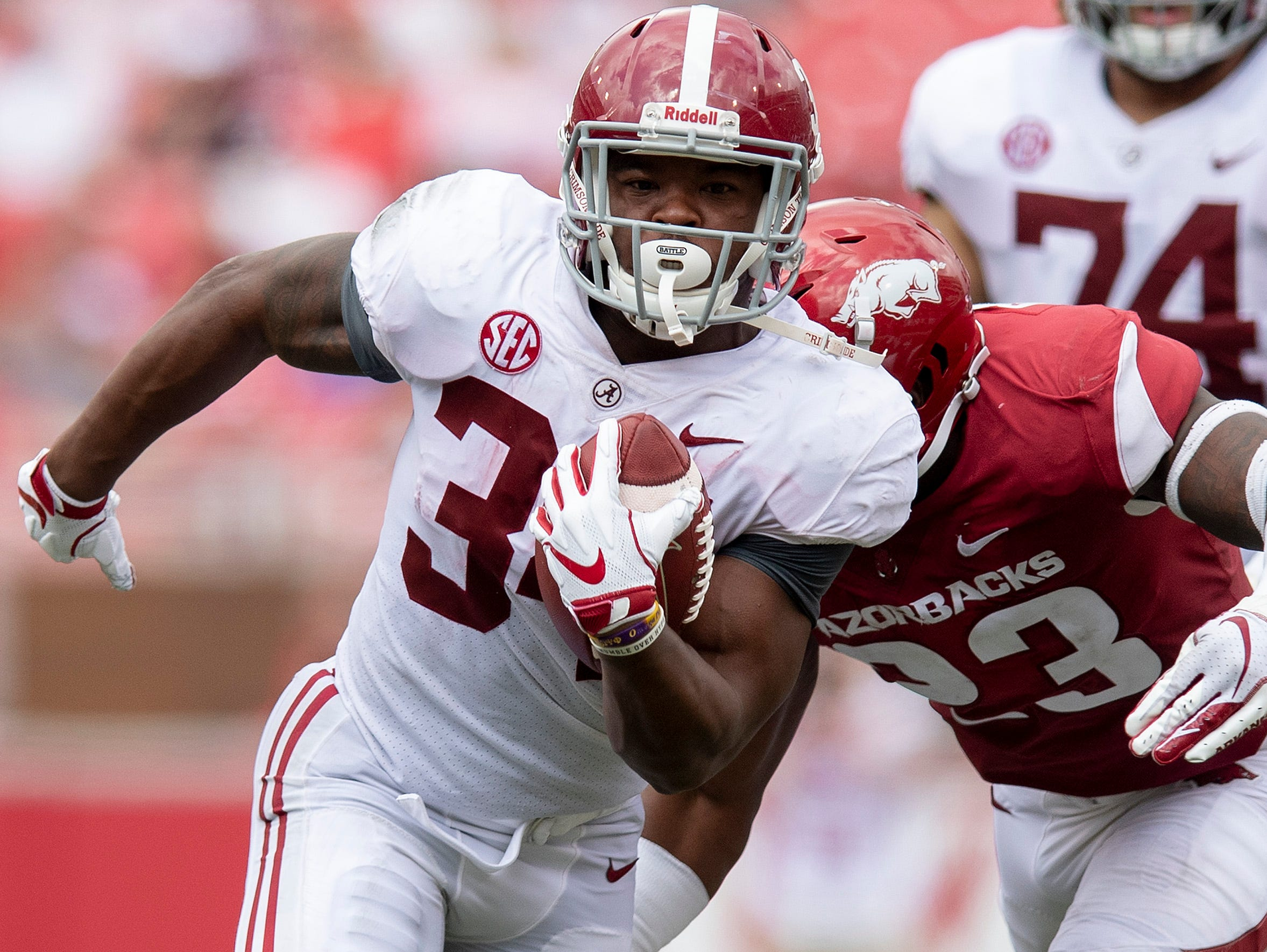 Alabama running back Damien Harris (34) carries the ball against Arkansas during second half action in Fayetteville, Ark., on Saturday October 6, 2018.