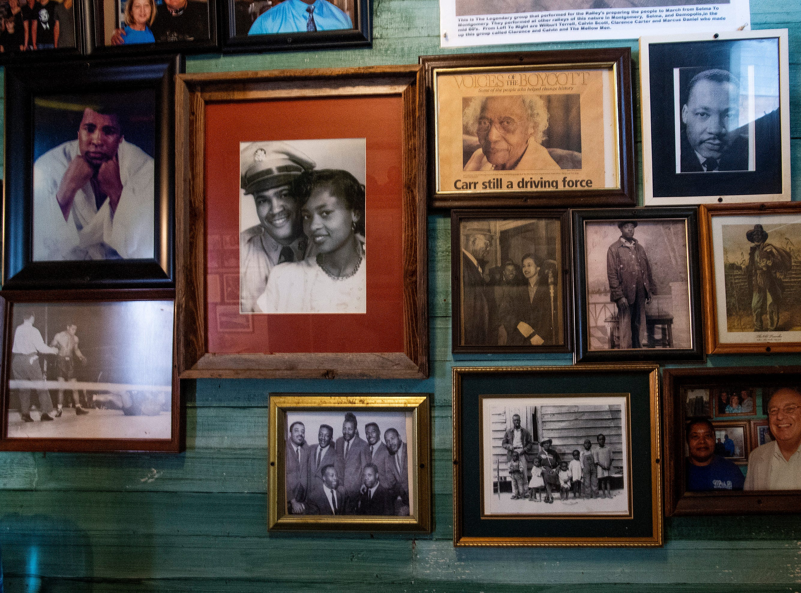 Photos hang on the walls off Mrs. B's Home Cooking in Montgomery, Ala., on Wednesday October 10, 2018.