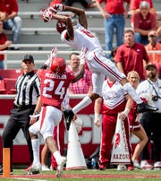 Alabama wide receiver DeVonta Smith (6) catches a pass pout of bounds against Arkansas defensive back Jarques McClellion (24) during second half action in Fayetteville, Ark., on Saturday October 6, 2018.