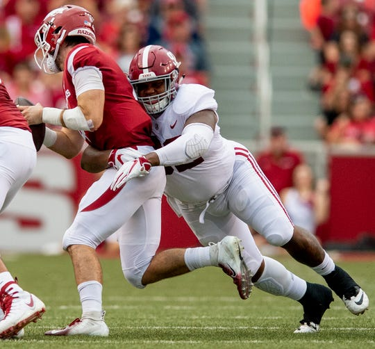 Alabama defensive lineman Quinnen Williams (92) wraps up Arkansas quarterback Ty Storey (4) during first half action in Fayetteville, Ark., on Saturday October 6, 2018.
