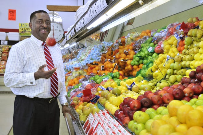 Greg Calhoun tosses an apple while at his Calhoun Foods store on Fairview Avenue on Wednesday, Feb. 8, 2012, in Montgomery, Ala.. (Montgomery Advertiser, Lloyd Gallman)