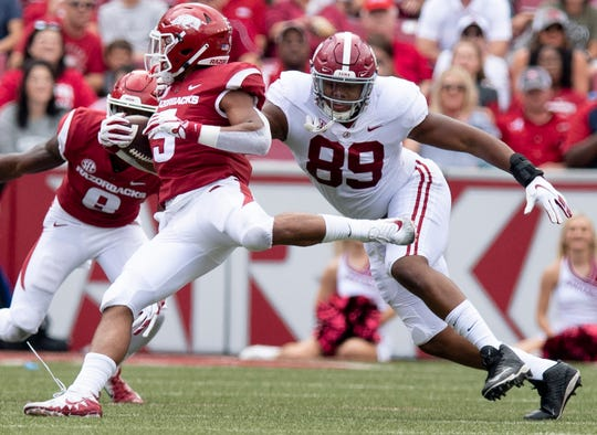 Alabama defensive lineman LaBryan Ray (89) chases Alabama tight end Ronnie Clark (5) during first half action in Fayetteville, Ark., on Saturday October 6, 2018.