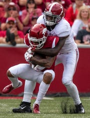Alabama defensive back Trevon Diggs (7) tackles Arkansas running back Rakeem Boyd (5) during first half action in Fayetteville, Ark., on Saturday October 6, 2018.