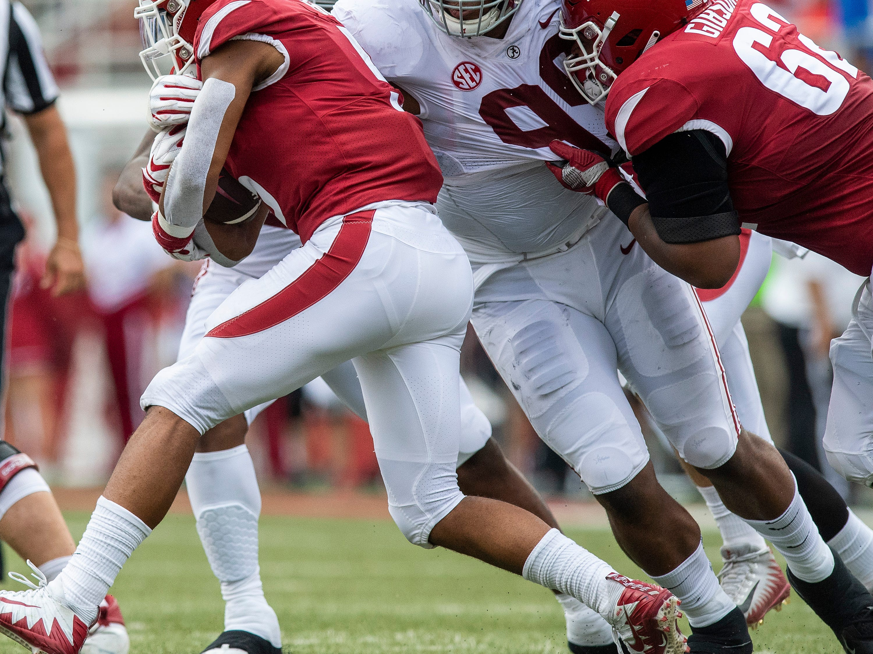 Alabama defensive lineman Raekwon Davis (99) stops Arkansas running back Rakeem Boyd (5) during first half action in Fayetteville, Ark., on Saturday October 6, 2018.